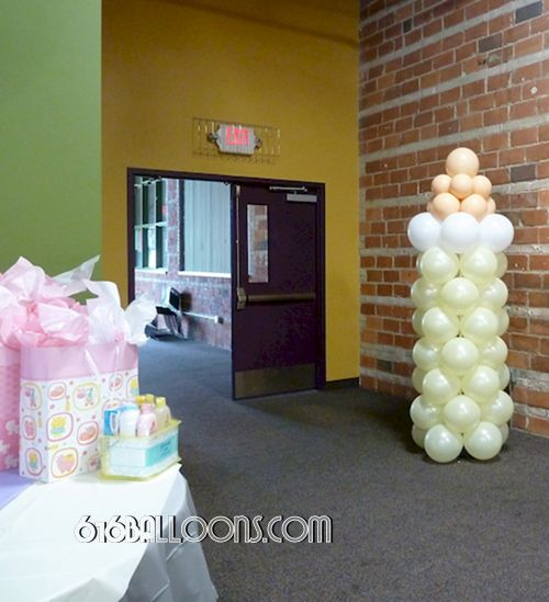 Baby shower bottle column by 616Balloons.com Grand Rapids, Michigan. Specializing in high end balloon art & decor for the best corporate or private parties and events in West Michigan.