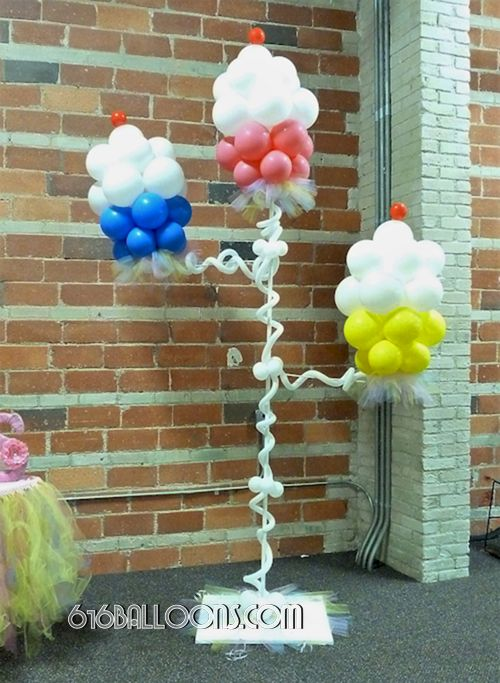 Baby shower cupcake balloon column by 616Balloons.com Grand Rapids, Michigan. Specializing in high end balloon art & decor for the best corporate or private parties and events in West Michigan.