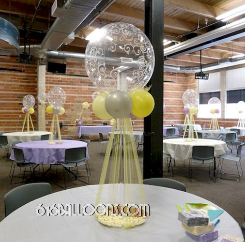 Elegant centerpieces with balloons and tulle for baby shower by 616Balloons.com Grand Rapids, Michigan. Specializing in high end balloon art & decor for the best corporate or private parties and events in West Michigan.