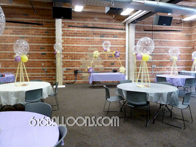 Elegant floral table arch and centerpieces with balloons and tulle baby shower by 616Balloons.com Grand Rapids, Michigan. Specializing in high end balloon art & decor for the best corporate or private parties and events in West Michigan.