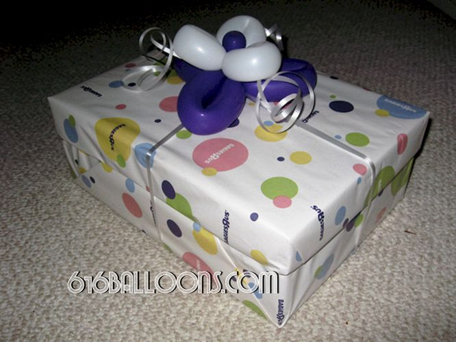 Balloon flower gift wrap decorations by 616Balloons.com Grand Rapids, Michigan. Specializing in high end balloon art & decor for the best corporate or private parties and events in West Michigan.