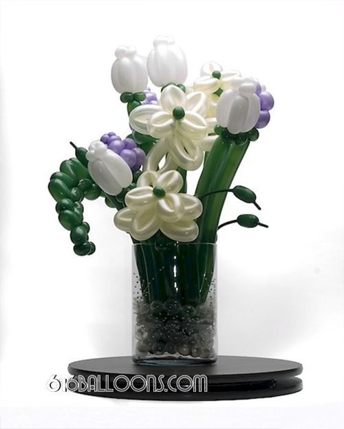 "Balloon flower arrangement in glass vase on 16"" 616 Art lazy Susan by 616Balloons.com Grand Rapids, Michigan. Specializing in high end balloon art & decor for the best corporate or private parties and events in West Michigan."