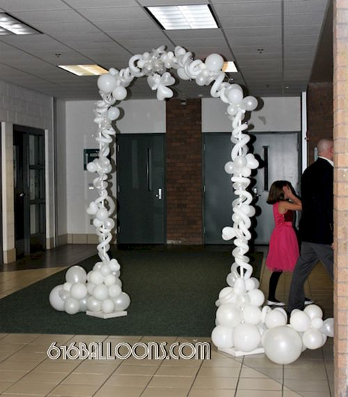 Angel arch balloon sculpture by 616Balloons.com Grand Rapids, Mi. Premium balloon art & decor. Corporate events, private parties..