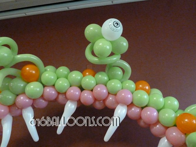 Monster table arch balloon sculpture eye & teeth detail by 616 Balloons Grand Rapids, Mi. Premium balloon art & decor. Corporate events, private parties.