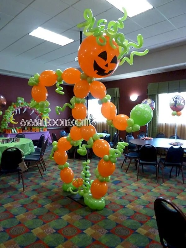 Giant dancing Jack-o-lantern balloon sculpture by 616Balloons.com Grand Rapids, Michigan. Premium balloon art & decor. Corporate events, private parties..