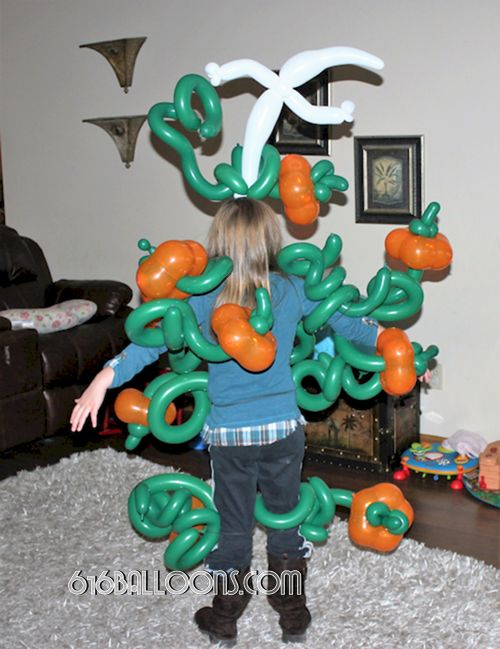 Balloon pumpkin patch costume with ghost headband by 616 Balloons Grand Rapids, Mi. Premium balloon art & decor. Corporate events, private parties..