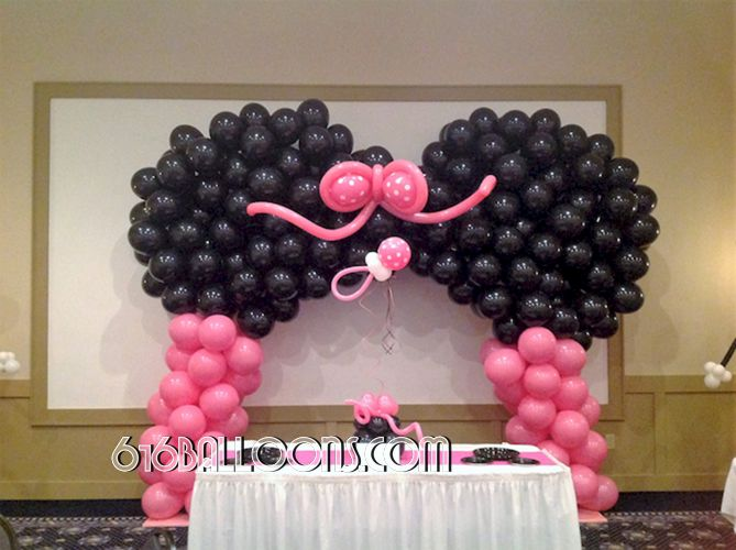 Minnie Mouse themed balloon arch and pacifier centerpieces for baby shower by 616Balloons.com Grand Rapids, Michigan. Specializing in high end balloon art & decor for the best corporate or private parties and events in West Michigan.