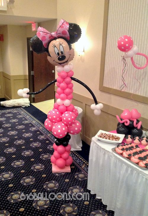 Minnie Mouse balloon column and pacifier centerpieces for baby shower by 616Balloons.com Grand Rapids, Michigan. Specializing in high end balloon art & decor for the best corporate or private parties and events in West Michigan.