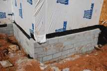 More block on footing - in front of dampproofing
