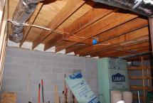 Spray-foamed floor cavities at perimeter of Basement wall