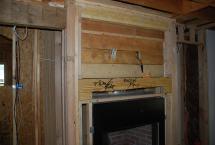 Recessed framed over fireplace for hidden TV