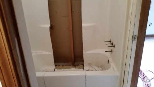 Upstairs shower/tub cut up for removal