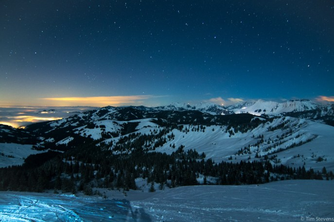 Looking east towards Bern. The brights lights to the right are piste groomers going about their evening activities.