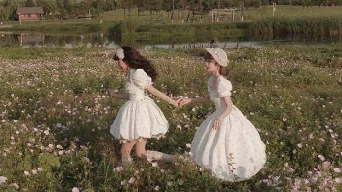 Women in white dresses