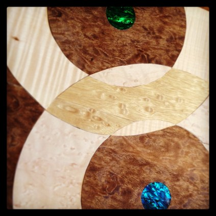 Inlaid circles and abalone shell