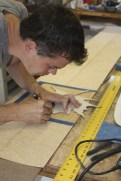 Vin cutting a maple leaf inlay