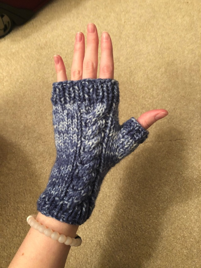 One of the fingerless gloves is being modeled on my left hand.  this wrist happens to also have a white bracelet on.