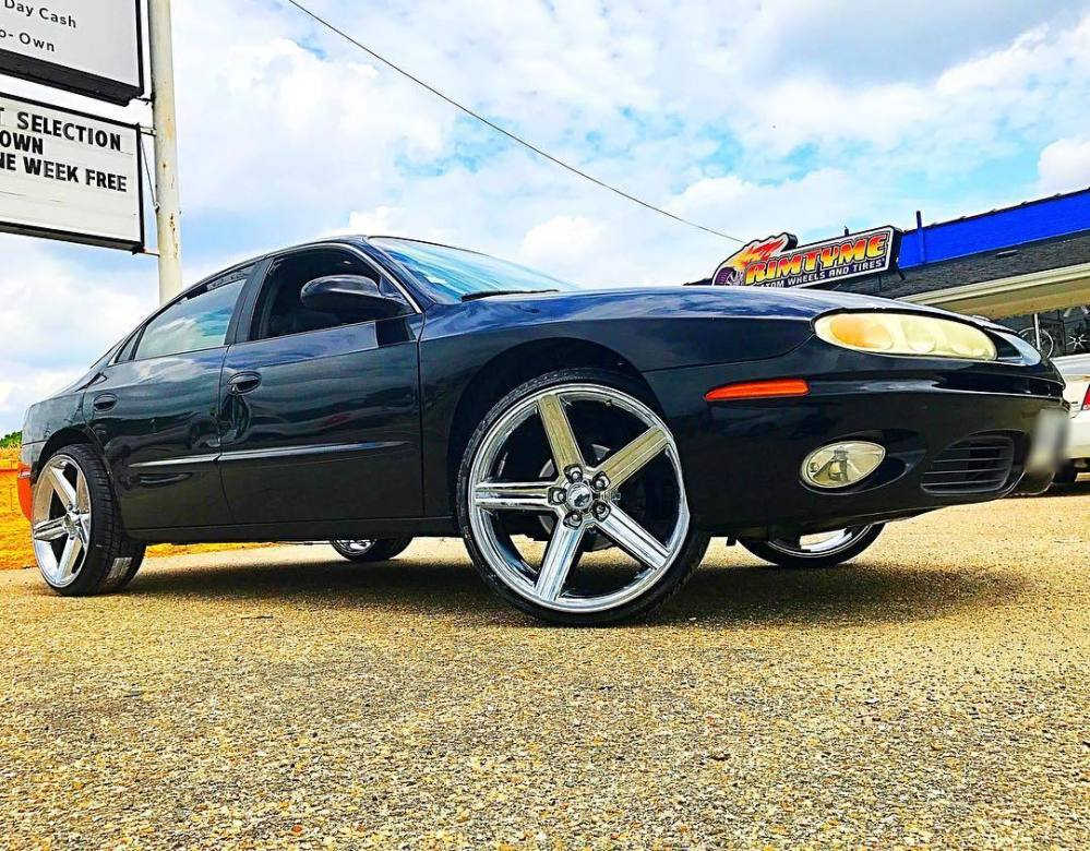 medium resolution of 2001 oldsmobile aurora sitting on 22 sik 051 chrome wheels with 235 30