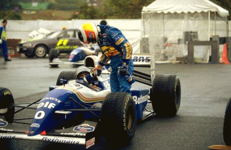 Michael Schumacher shaking hands with Damon Hill after the Japanese Grand Prix in 1994.