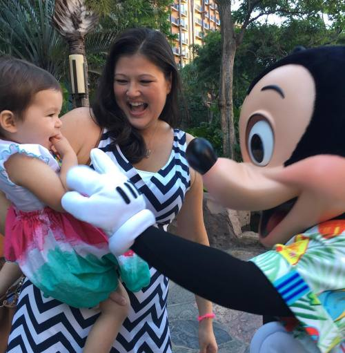 Introducing Emma to my favorite mouse! (at Aulani's Makahiki Character Breakfast)