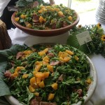 A picture of a huge salad display for catering