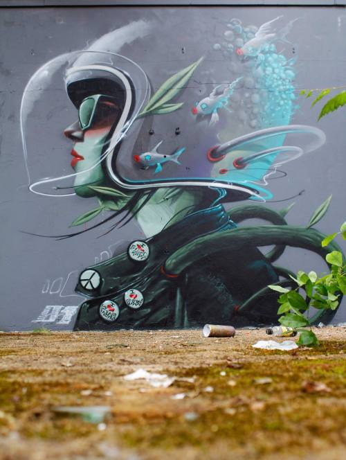 crossconnectmag:Street art by Rocket01  Born in Sheffield, UK, Rocket01′s art mixes nature, society and science fiction. As many artists, he started with lettering and slowly switched to a figurative photorealism. He now often creates portraits inscribed in surreal scenarios and painted with pastel colours. The result is strangely expressing both comfort and disturbance. Previous article featuring other murals.Check our Twitter and Facebook for more original ArtSelected by Very Private Art