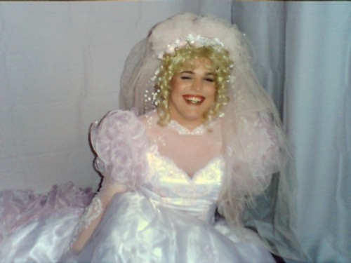 This young and beautiful bridal crossdresser is  The