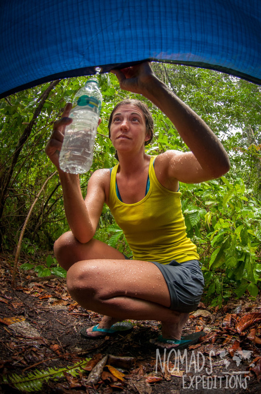 nowhere papua indonesia forest jungle wild wilderness tribal traditional culture travel adventure explore trek discover journey guide wonder dangerous survival village island tropical remote undiscovered water collection rain bottle tarp tent storm