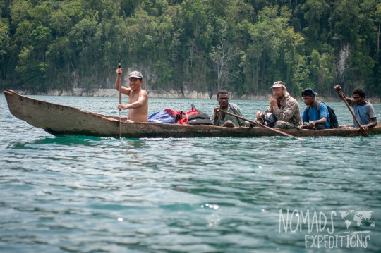 nowhere papua indonesia forest jungle wild wilderness tribal traditional culture travel adventure explore trek discover journey guide wonder dangerous survival village island tropical remote undiscovered boat travel paddle traditional canoe wood dugout