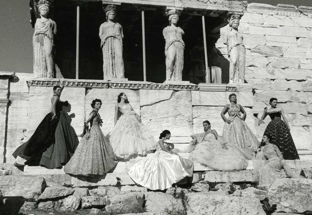 Christian Dior models under the caryatids of the Erechtheion temple on the north side of the Acropolis in Athens, Greece (1951). credit: This picture was taken by PEDRAZZINI for PARIS MATCH magazine during a show in Athens in 1951.