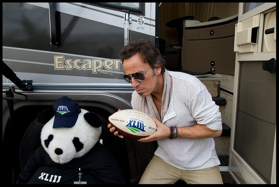 Bruce Springsteen holding a football