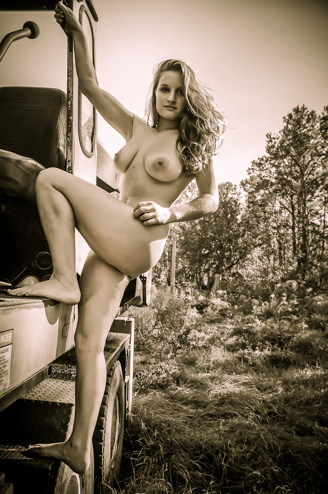 Sometimes you find abandoned construction equipment in the woods, so you climb on it.