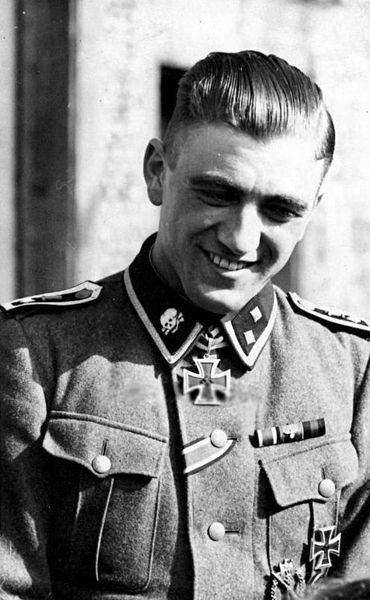 Oberscharführer SS Ludwig Köchle volunteered for the SS in 1938. By 1941, he had won the Iron Cross 1st and 2nd class. He excelled in fighting near Demyansk when his platoon destroyed six enemy bunkers and MG positions using hand grenades. Köchle led...