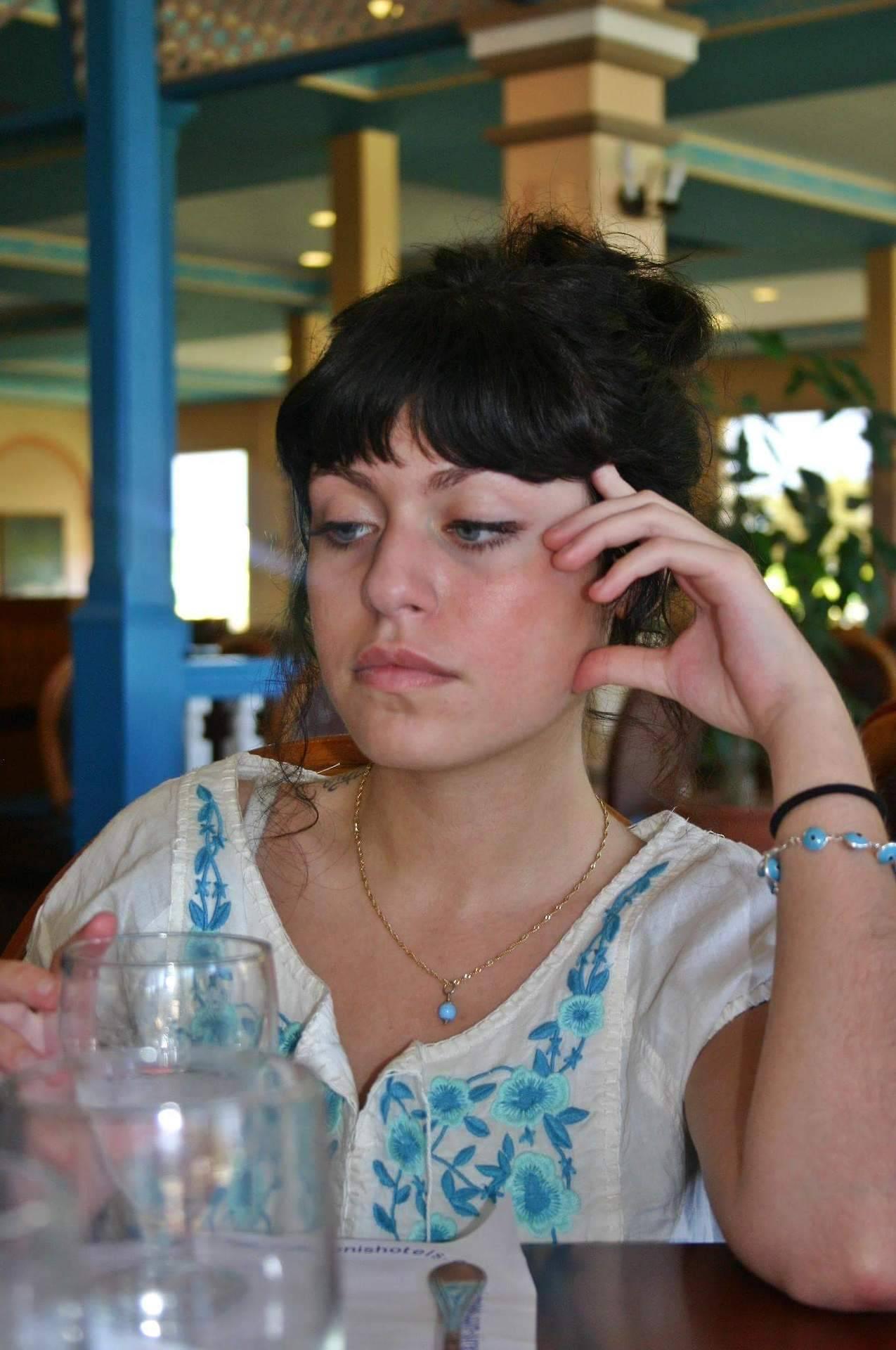 Aryana enjoying some white wine-