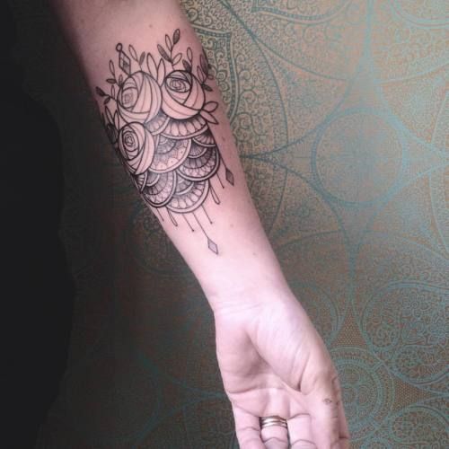 Ornamental flower tattoo by Caroline Karenine.