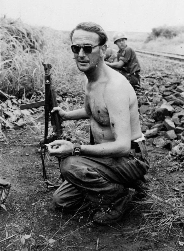 Major Erik Bonde smokes a cigarette after being hit by two…