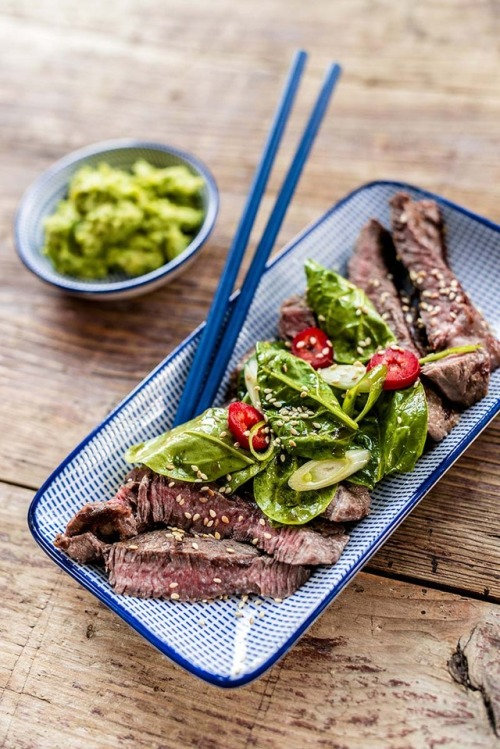 Steak japanese style with spinach salad and avocado-wasabi dip