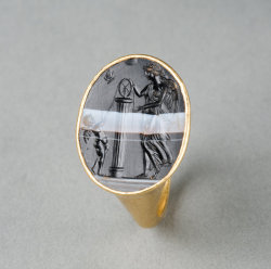 gemma-antiqua:Hellenistic gold ring with sardonyx intaglio of Nemesis, Eros, and Psyche as a butterfly, dated to the 1st century BCE. Found on Antiquarium, Ltd.