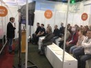 Lorcan Presenting to a packed Tech Box