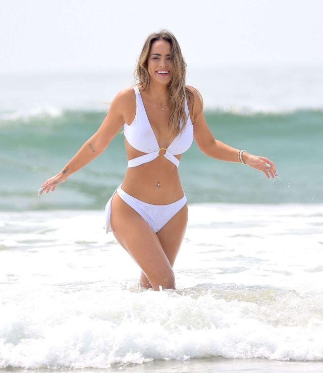 Beautiful Lauren Coogan Hits The Beach In White Bikini