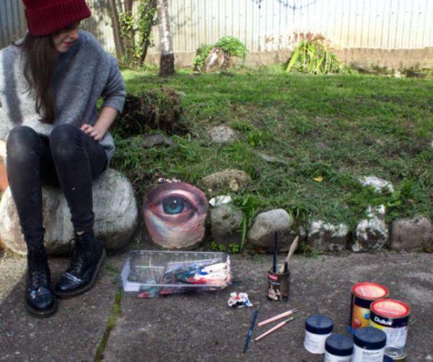 An Artist That Paints Eyes On Rocks