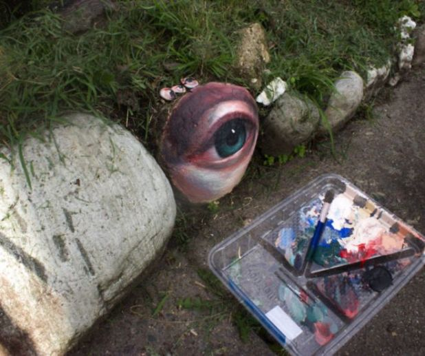 An Artist That Paints Eyes On Rocks