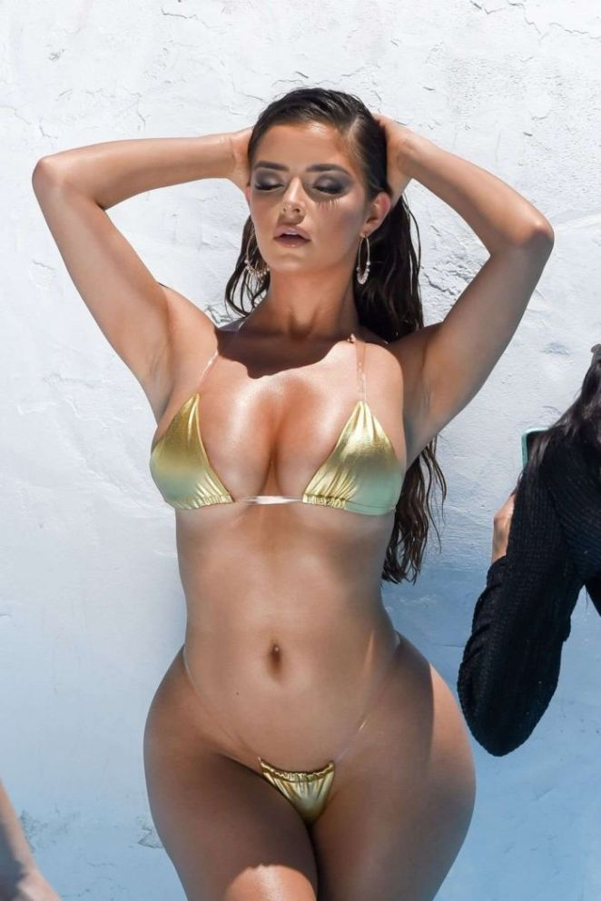 Demi Rose Shines Bright For A Golden Bikini Photoshoot
