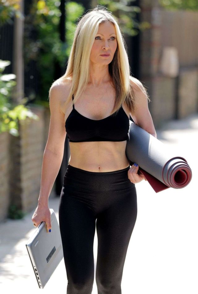 Caprice Bourret Practicing And Streaming Her Online Yoga Classes From A Park In London