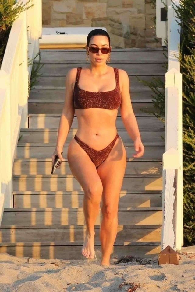 Kim Kardashian In A Maroon Quaran-Kini At The Early Sunrise Beach Stroll In Malibu