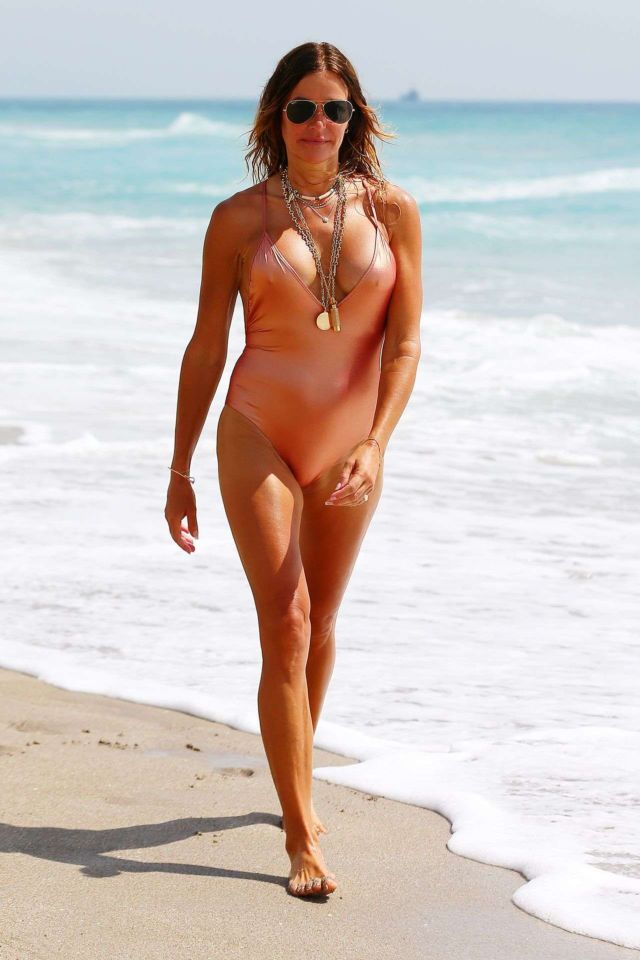 Kelly Bensimon In A Golden Swimsuit At The Beach