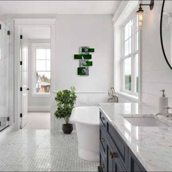 restroom space with metallic green and silver contemporary art