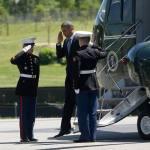 President Obama saluting Marines.