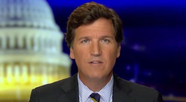 tucker carlson says elites want lockdowns to usher in the great reset