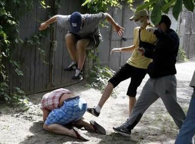 Thugs beat gay activist in Ukraine (Photo courtesy of Reuters)